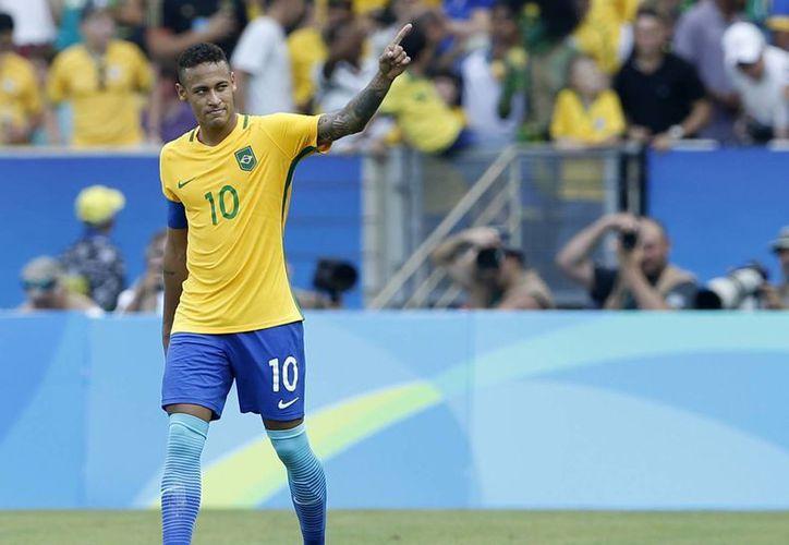 El brasileño Neymar consiguió el gol más rápido del torneo al marcar a los 14 segundos frente a Honduras. (Silvia Izquierdo/AP)