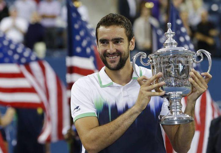 El croata Marin Cilic con el trofeo de campeón del US Open 2014. (AP)