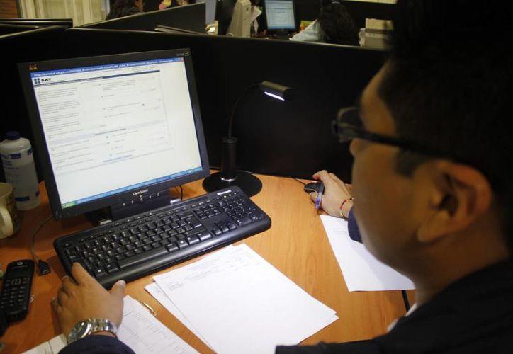 Hay al menos 15 empresas en la ciudad que venden desde Internet. (Sergio Orozco/SIPSE)