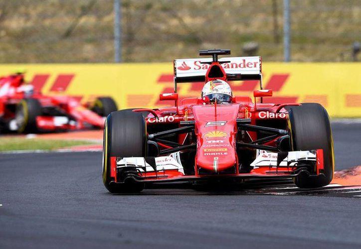 Sebastian Vettel ganó la accidentada carrera del Gran Premio de Hungría de Fórmula 1. El mexicano 'Checo' Pérez volvió a perderse en la competencia. (Efe)