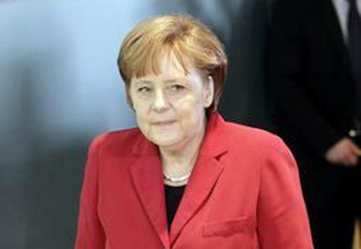 La semana pasada la canciller Merkel envió sus deseos de una pronta recuperación a la leyenda de la Fórmula 1 Michael Schumacher quien se accidentó el pasado 29 de diciembre. (Agencias)