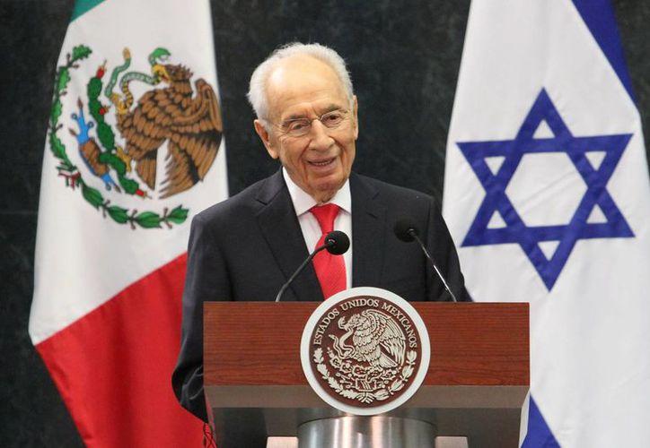 Con un negocio se trata de 'hacer servicios a favor de la población', expresó el presidente de Israel, Shimon Peres, durante su participación en el Strategic Business Forum México Israel. (Notimex)