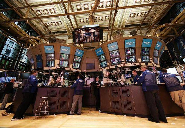 United Health y Merck fueron los mercados que no festejaron el ascenso en la bolsa de valores. (EFE)