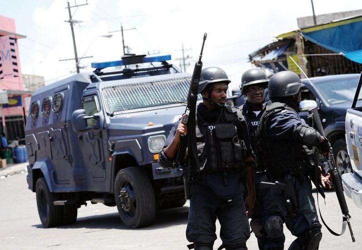La unificación de los dos cuerpos pondrá fin a la diferencia en beneficios sociales para los agentes, que ha favorecido al Cuerpo de Policía de Jamaica por encima de la Policía Especial. (Archivo/EFE)