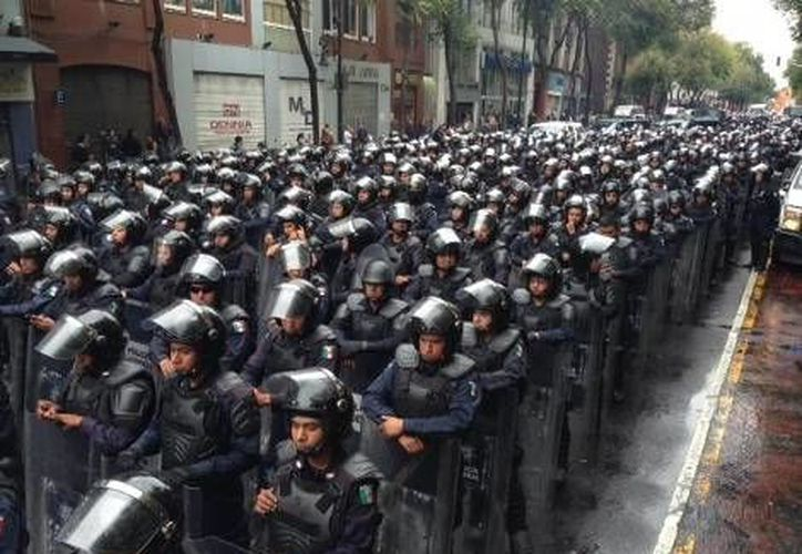 El gobierno ya busca alternativas a los exámenes de confianza actuales aplicados a policías. (Milenio/Foto de contexto)