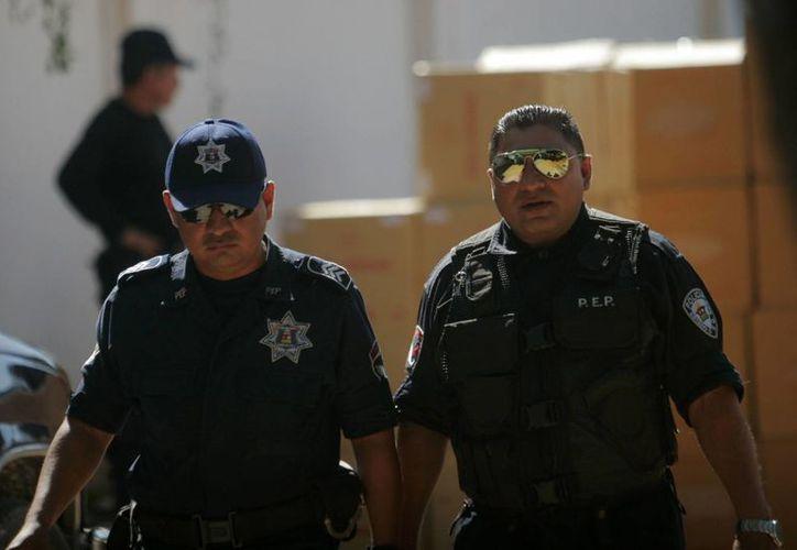 El avance estatal en materia de evaluación de las policías es apenas superior al 10 por ciento. (Harold Alcocer/SIPSE)
