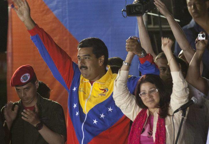 El presidente encargado de Venezuela y aspirante en las elecciones presidenciales, Nicolás Maduro Moros, festejó su triunfo en las primeras horas de este lunes. (Agencias)