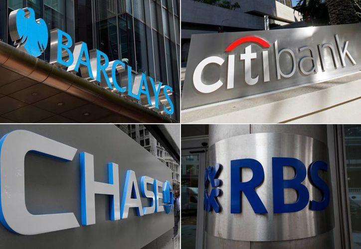 Imágenes de los logotipos de los bancos Barclays, Citigroup, JPMorgan Chase y The Royal Bank of Scotland, multados por manipulación del dólar y euro en el mercado de divisas. (Foto The Associated Press)