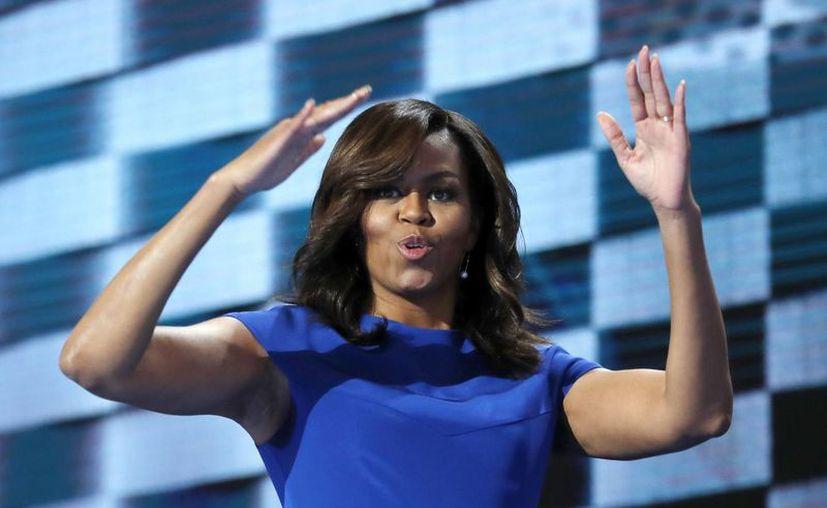 Michelle Obama elogió el carácter y determinación de 'su amiga Hillary Clinton'. (AP)