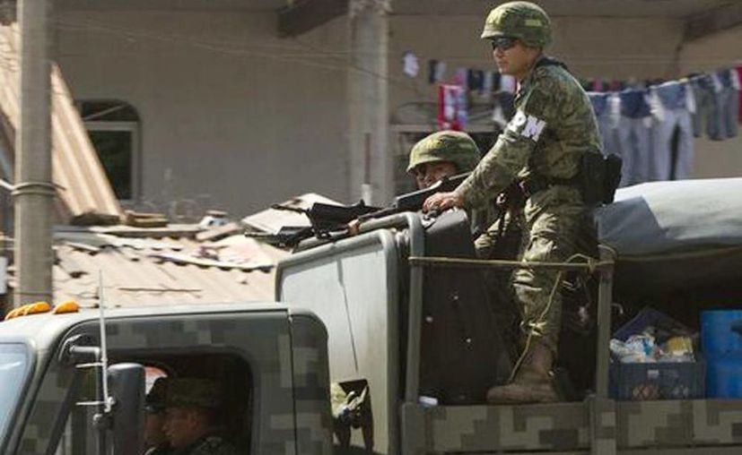 Elementos del Ejército patrullan la zona. (Jesús Quintanar/Milenio)