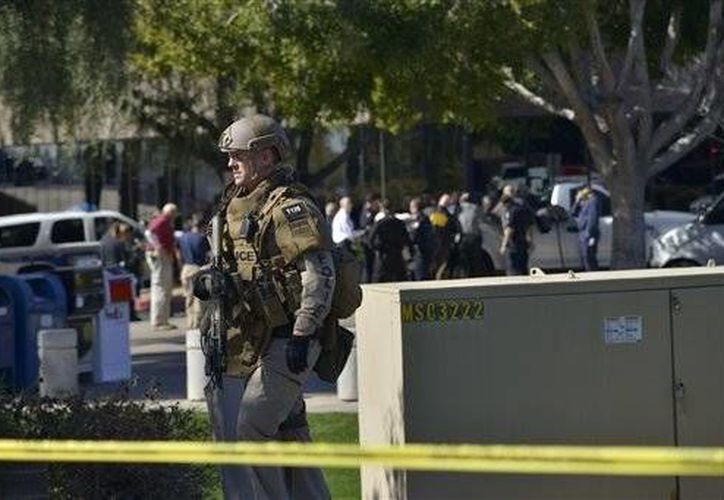 Vecinos del lugar dijeron haber escuchado disparos antes del hallazgo de los cuerpos. (Archivo/AP)