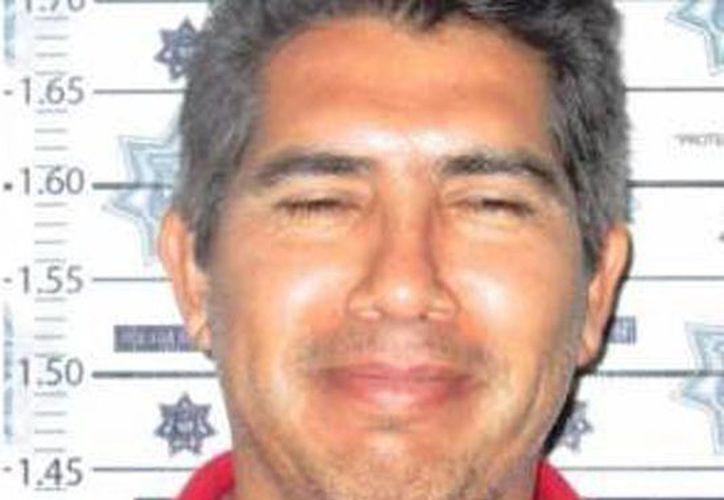ex jefe de finanzas de la Secretaría de Salud de la entidad, Carlos Tito Rangel Hernández, fue arrestado cuando circulaba en una camioneta tipo Hummer con placas del Estado de Hidalgo. (spiaboc.com.mx)