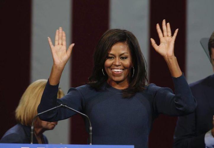 La primera dama estadounidense, Michelle Obama, participó en un acto de campaña de la candidata demócrata Hillary Clinton, en Manchester, Nuevo Hampshire, EU, el 13 de octubre de 2016. (EFE)