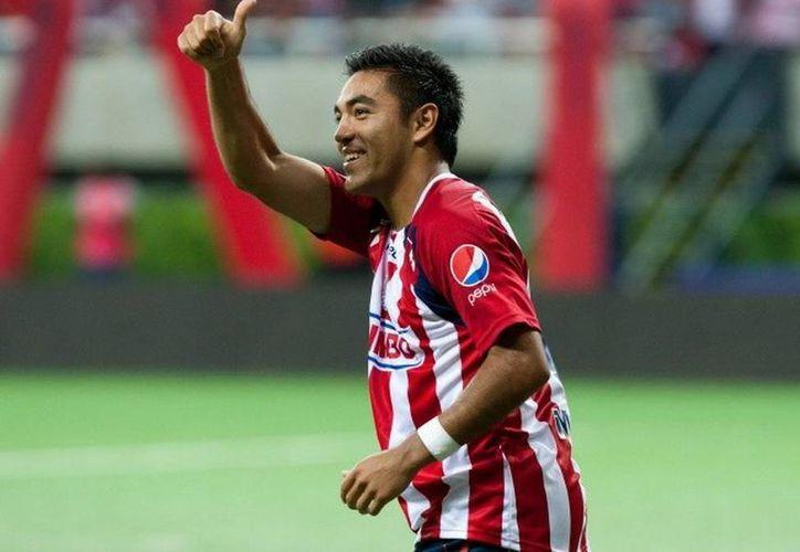 En lo que se va a Qatar, Chivas no deja que Marco Fabián de la Mora deje de entrenar. (Archivo Notimex)