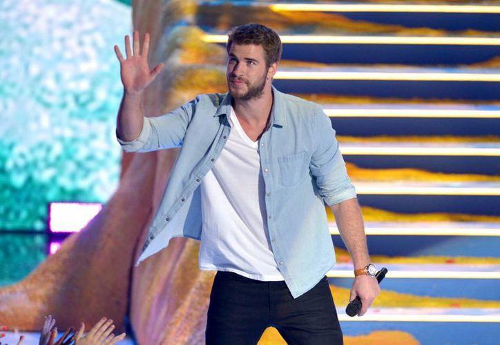 Liam Hemsworth fue uno de los presentadores de los premios Teen Choice. (Agencias)