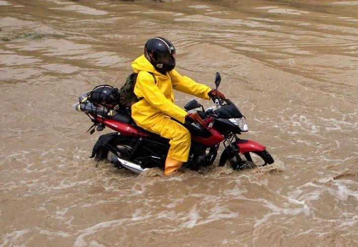 La UGRD informa que entre el 15 de marzo, fecha que marca el comienzo de la primera de las dos temporadas de lluvias en Colombia, y este domingo fueron destruidas 699 viviendas y 14,393 resultaron dañadas. (EFE/Archivo)