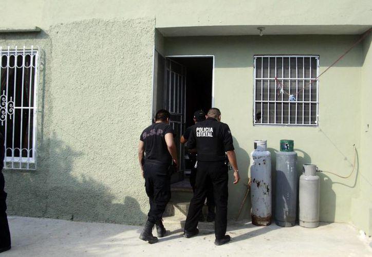 Los ladrones generalmente fuerzan las puertas traseras para entrar a las viviendas. (Christian Ayala/SIPSE)