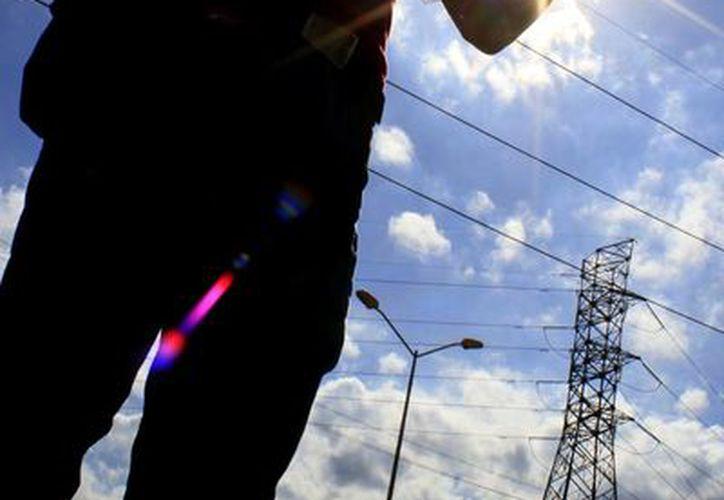 La aplicación del horario de verano en el país, durante el 2014, permitió un ahorro en el consumo de energía de mil 116 gigawatts. (Sergio Orozco/SIPSE)