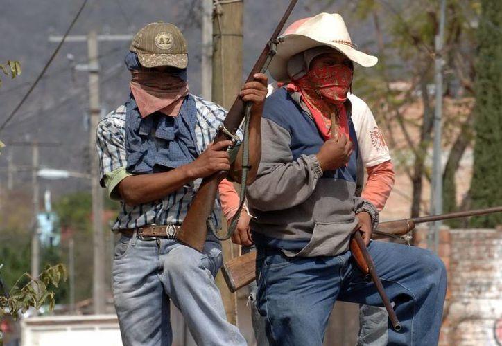 Habitantes de Atliaca y Acatempa del municipio de Tixtla de Guerrero aún no han retirado sus retenes ciudadanos. (Archivo Notimex)