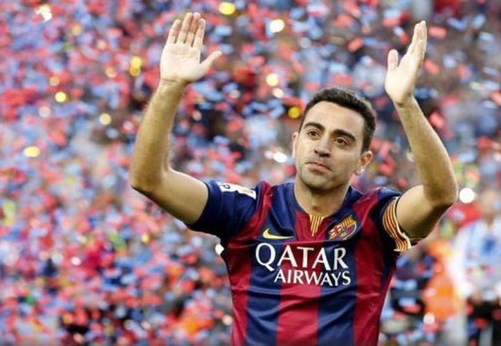 El jugador Xavi descartó dirigir al Barça a corto plazo. (Reuters)