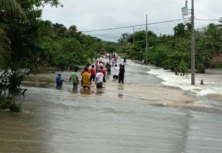 La entidad solicitó al Fondo de Desastres Naturales federal, recursos para la reconstrucción de las zonas que se inundaron. (Harold Alcocer/SIPSE)