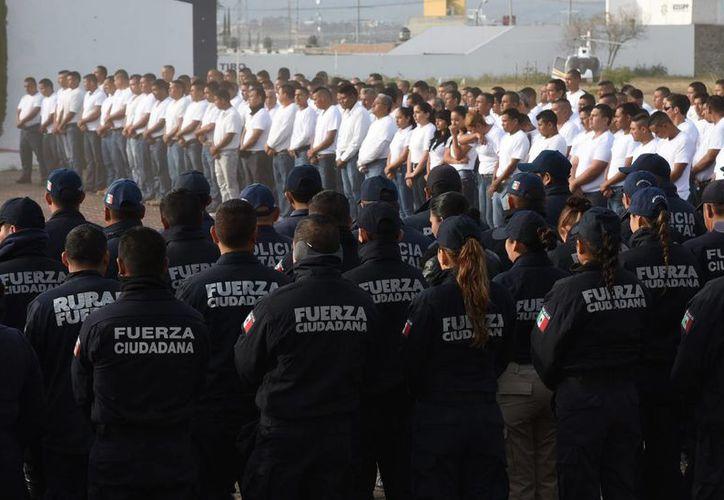 El programa de seguridad contará con un fondo de 7 mil millones de pesos para las tareas de seguridad. Imagen de contexto de un grupo de policías de la Fuerza Ciudadana. (Gustavo Salas/Notimex)