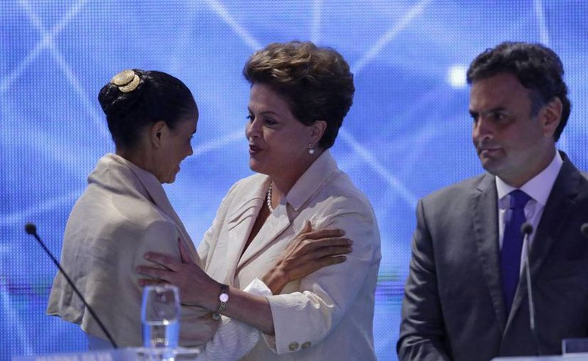 Marina Silva y Dilma Rousseff encabezan las preferencias electorales por la Presidencia brasileña; detrás está el candidato Aecio Neves. (AP)