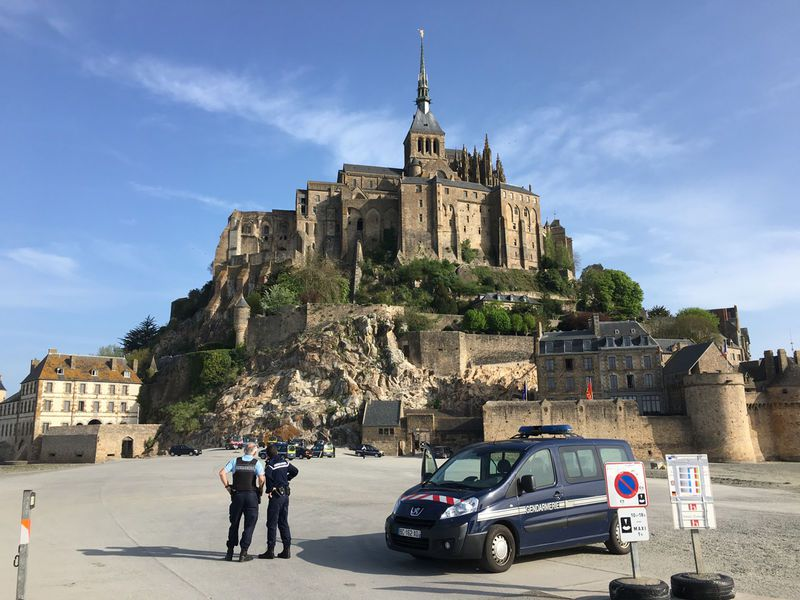 Police attend the scene of an evacuation at Mont Saint-Michel, on France's northern coast.