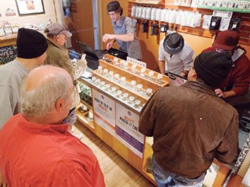 Employees of Amazon Organics, a pot dispensary in Eugene, Ore., help customers purchase recreational marijuana. (AP)