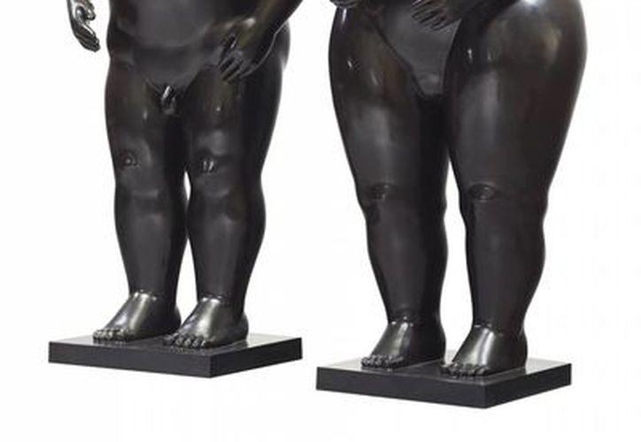 En Christie's, la obra de Botero Adán y Eva, unas esculturas de bronce de un hombre y una mujer corpulentos y desnudos, alcanzó los 2.57 millones de dólares. (Agencias)
