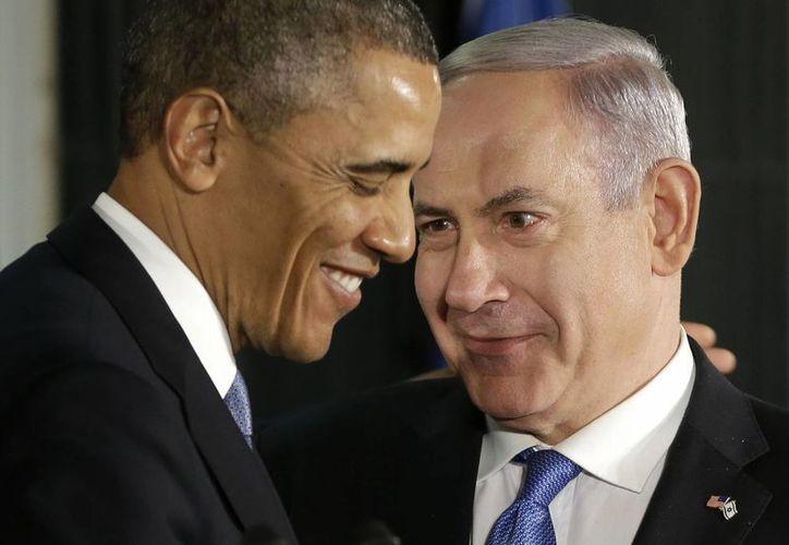 Imagen de marzo de 2013, del presidente de EU Barack Obama y el primer ministro de Israel, Benjamín Netanyahu, en Jerusalén. Hoy, Obama admitió desacuerdos por el programa nuclear de Irán. (Archivo/AP)