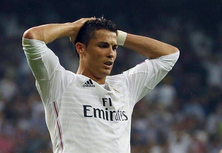 Al parecer, Cristiano Ronaldo y sus compañeros 'perdieron' el primer torneo de la temporada luego de que fue ratificada su eliminación de la Copa del Rey por una alineación indebida. (Archivo EFE)