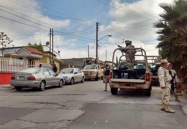 Las fuerzas castrenses resguardaron el domicilio donde se encontró el narcotúnel. (La Jornada BC)