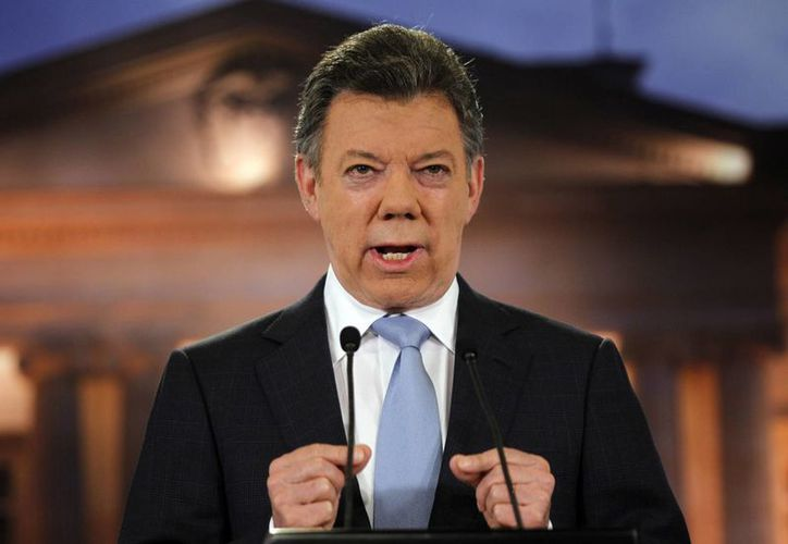 El presidente Juan Manuel Santos entregó las viviendas. (Agencias)