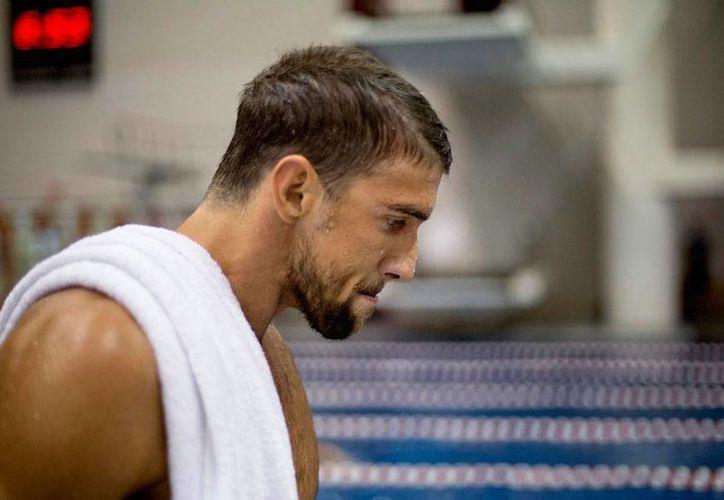 El nadador Michael Phelps, el máximo ganador de mellas en los Juego Olímpicos, estuvo bajo arresto por manejar en estado de ebriedad y a exceso de velocidad. La imagen es de archivo y utilizada como contexto. (AP)
