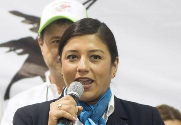 Evelyn Carrera, adjudicadora del Récord Guinness, dijo que el registro de la cochinita pibil más grande del mundo aparecerá en la página de internet del Guinness. (Amílcar Rodríguez)