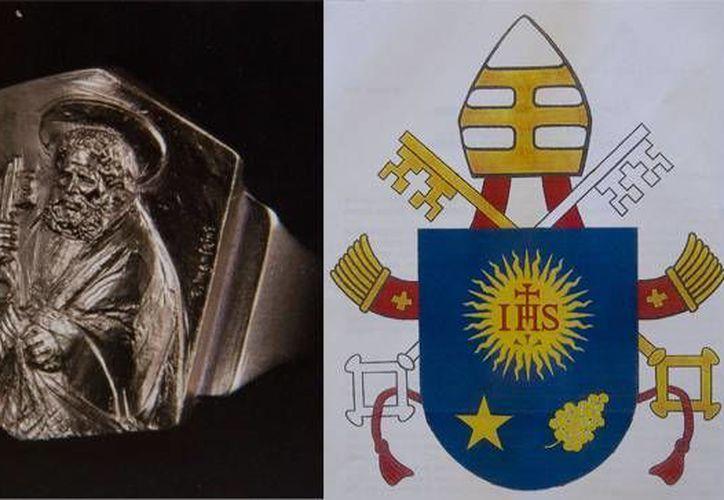 Anillo papal bañado en oro, y escudo de armas que usará el Papa Francisco, según la Santa Sede. (AP)