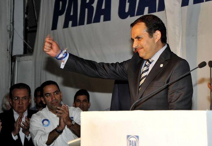 Según Gustavo Madero, líder del PAN, el descuento a las percepciones de Ernesto Cordero no ayuda a resarcir el daño. (Notimex)