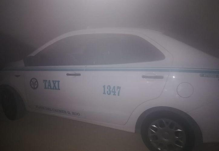 El cuerpo del taxista tenía varios disparos de bala. (Redacción/SIPSE)