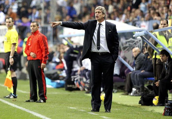 Pellegrini reconoció que su felicidad no es completa ante el castigo de la UEFA al Málaga. (EFE)