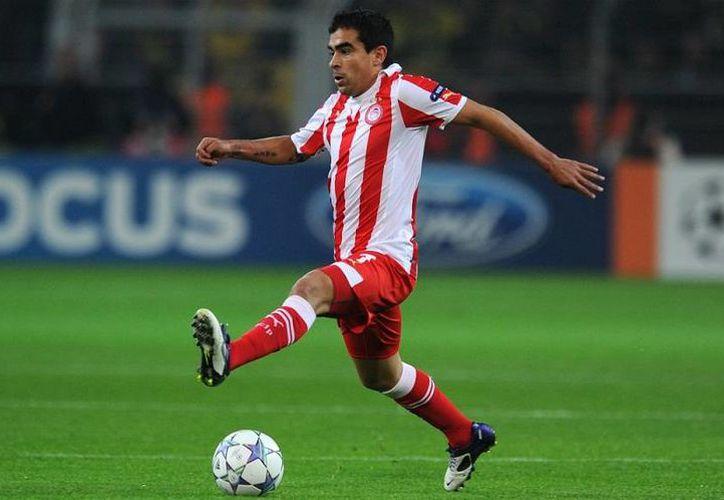Selecciones y clubes griegos como el Olimpiakos, que actualmente disputa la UEFA Champions League, podrían ser castigados por la FIFA y la UEFA. (goal.com)