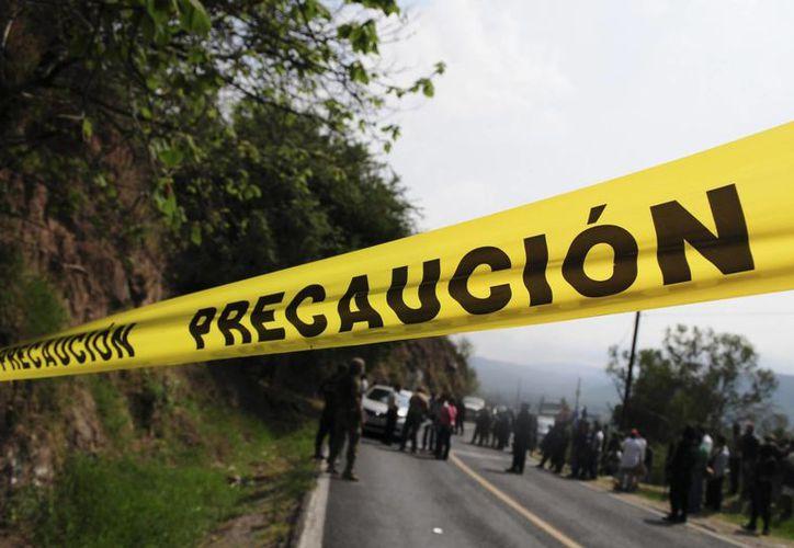 Un grupo de hombres armados sacó de su casa a cuatro jóvenes de 16 a 23 años en la comunidad de Tonalapa. Imagen de contexto. (hoymineria.com)