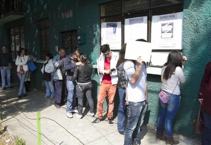 En las elecciones de 2012 votaron más de 40 mil mexicanos residentes en 92 países. La imagen corresponde a un módulo de trámite de credencial para votar en la Ciudad de México. (Archivo/Notimex)