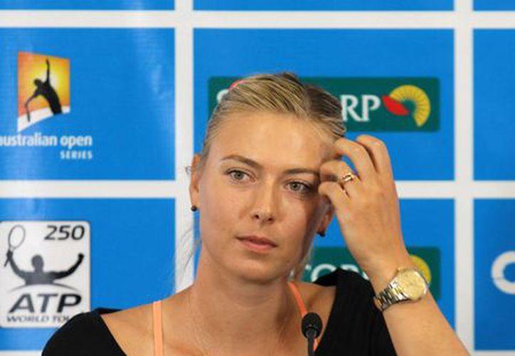 Maria Sharapova planea usar el torneo de Brisbane como el trampolín para su regreso y observar cómo funciona su nuevo equipo de entrenadores. (Agencias)