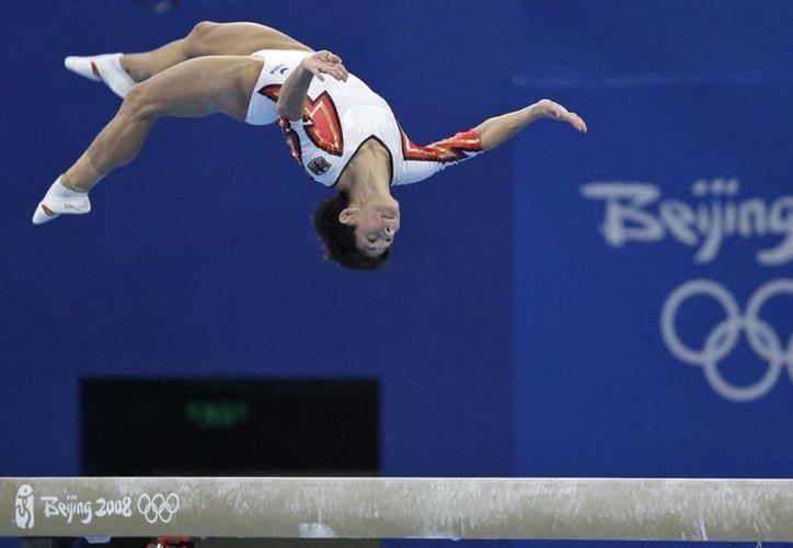 Una aplicación de transporte ayudará a que en Río de Janeiro no haya tanto tráfico por los Juegos Olímpicos. En la foto, de contexto, la gimnasta alemana Oksana Chusovitina. (AP)