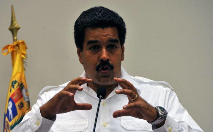Snowden forma parte de 'la rebelión de la ética', dijo Maduro. (EFE)