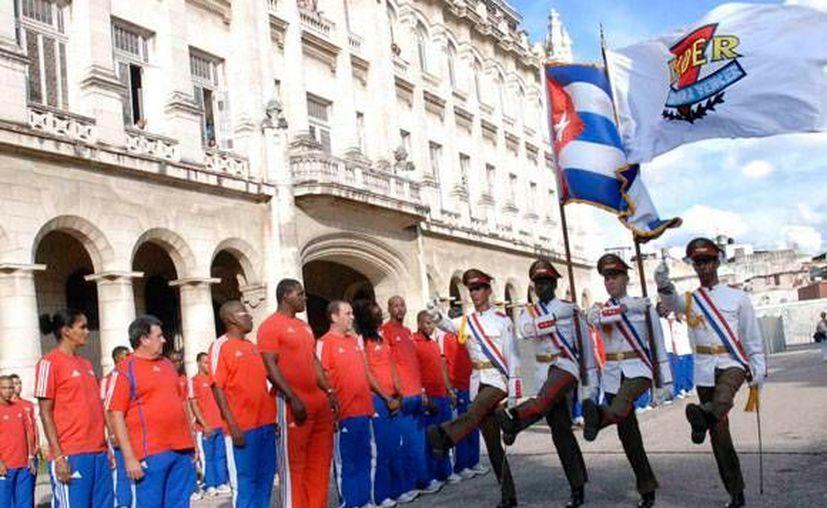 Los atletas cubanos se quedarán con el 80% del valor de los premios internacionales, los entrenadores con el 15% y los especialistas con el 5%. (cubadebate.cu)