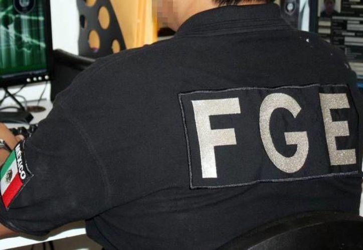 Un hombre y su hijo de 16 años fueron detenidos en Yucatán por agentes de la FGE al tratar de cobrar dinero en efectivo por un secuestro que nunca ocurrió. (Foto de contexto de SIPSE)