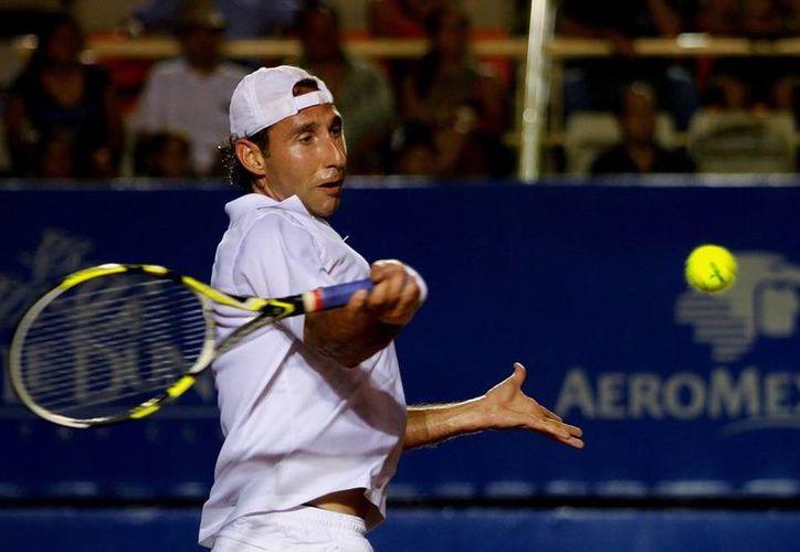 Santiago González fue despachado en poco más de una hora, en la primera ronda del torneo chino. Imagen de archivo de su participación, el año pasado, en el Abierto Mexicano. (Agencias)