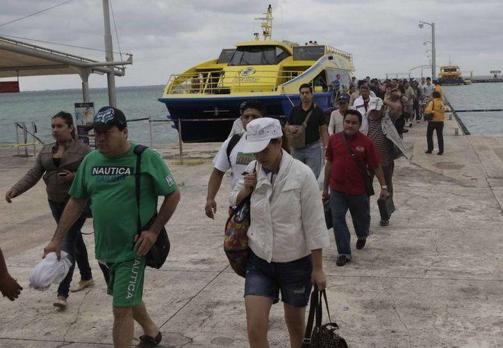 Hasta el 25 de marzo habían cruzado a la isla alrededor de 393 mil 53 visitantes. (Redacción/SIPSE)